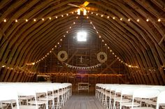 light strung rustic barn wedding ceremony venue http://lauryngallowayblog.com/ http://www.ambergrove.com/