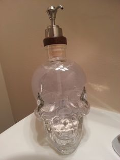 Soap Dispenser: Finally found something to do with the empty crystal head vodka bottle we had laying around.