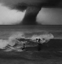Surfing in the storm photography rain storm sky ocean clouds nature No Wave, All Nature, Amazing Nature, Surf Mar, Fuerza Natural, Wild Weather, Tornados, Thunderstorms, Natural Phenomena