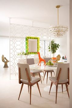 Jonathan Adler :: Interior Design  Love, love,love the houndstooth covered chairs and the screen