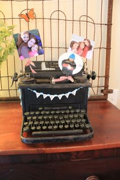 """old typewriter to hold photos, the bunting is stamped w/ """"create"""" in typewriter font."""