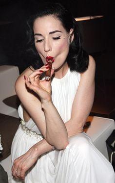 Lovely Dita smoking a cigar