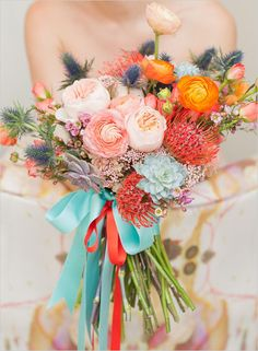 This bouquet is out of control! The incredible combo of colors and textures with Scuba Blue and Tangerine Tango ribbons makes this wedding look like quite the fiesta!