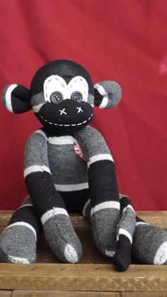 My friend makes these. Check out her site! This one is my favorite.  Roger Handstitched sock monkey. Stands approx 6 by ChikiMonkeys, $25.00