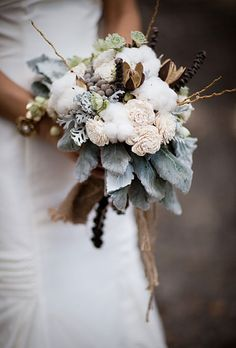 Brides.com: Winter Wedding Flowers                          Wedding bouquet of cotton, wood Sola flowers, lily and eucalyptus pods, banana stem, berzelia berries, silver brunia, astrantia, scabiosa, and dusty miller by Lauryl Lane Browse more white wedding bouquets.                                                                                 Photo: Jasmine Star Photography