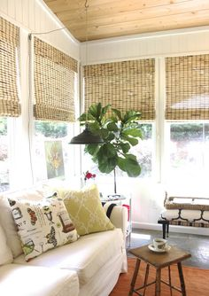 Love this sunroom!  The pillow section is my first stop at Homegoods.... found this beauty  for a sunny porch makeover!