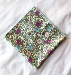 White floral pocket square with purple, blue and pink flowers - a great pop of color when you need to freshen up your outfit