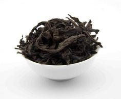 RED ROBE DA HONG PAO: FULL, FLORAL SWEET, AND A SUBTLE WOODY SCENT: a lightly oxidized oolong from Wuyi Mountain in Fujian, China. Its big, dark leaves smell caramelized and woody roasted. A slight astringency and full, sweet, round flavors of barley, raisins, and charred wood make Red Robe Oolong a great choice for sophisticated black tea drinkers.