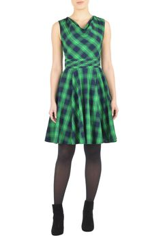 A draped neckline and pleating at the inset high waist style our cotton check dress with a full skirt for flirty twirl.