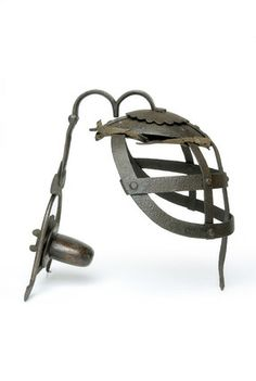 Scold's Bridle: 17th century- Scold's Bridle. This instrument of punishment reserved for women prisoners originated in medieval Scotland. It consisted of a metal head cage with a built in gag.