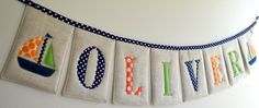 Name bunting, love the rectangular shapes of the flags.  And on linen!