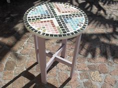 Re-purposed round side table with a fresh coat of paint and mosaics.