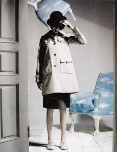 """While this Vogue Korea shoot entitled """"Simple is More"""" by Kim Han Jun, isn't exactly a replica of Magritte's oeuvre (like in Sir Realist), it's clear that his work was the driving force behind its visuals. Magritte's staples are all over this, with the use of clouds, bowler hats, umbrellas and the posing of the scenery.  Really, all that is missing is a pipe, to clearly link it to one of Magritte's most famous paintings."""