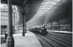 A steam train passing through the station in Newcastle, 1884