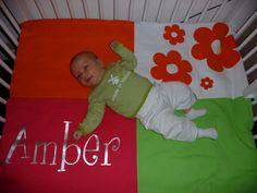 Amber op haar geboortekleed