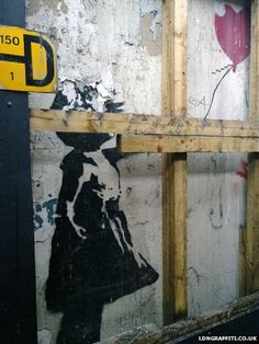 London Banksy Girl and Balloon mural to be removed - A famed stencil image of a girl with a balloon by graffiti artist Banksy is being removed from the wall of an east London shop and sold.
