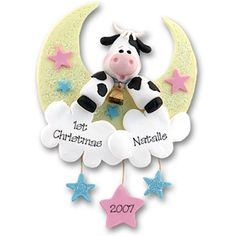 ...And the cow jumped over the moon...proving some things in life are always in style!  This classic design is perfect for the new boy or girl in your life! Done in pastel colors to work in any nursery decor with just enough glitter to catch your eye. It comes complete with a hook and satin ribbon for hanging. Handmade from polymer clay and designed by Debi Allison.