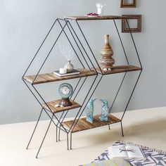 cca31ded3 The open metal frame and the wooden shelf together offers easy storage and  voguish organization.  FabulivDecor  wallshelves  storagesolution   countrystyle ...