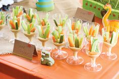 Get some plastic cups and fill the bottom with humus and then stick some veggies in - snack time!