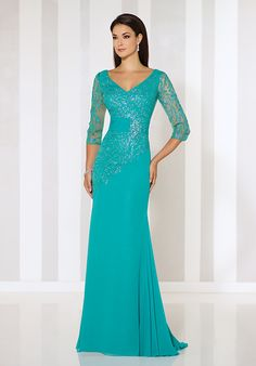 Chiffon sheath with glitter printed illusion three-quarter length sleeves, front and back V-necklines, glitter printed bodice with asymmetrically dropped waist and ruched midriff,