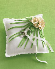 Wedding Colors: Green and White Ring Pillow Tender greens radiate from delicate shell-pink blossoms on this linen-and-felt ring cushion, which was designed exclusively for us. Ring pillow was custom made by Llubav Choy Duerr, wedding bands by Benchmark. Ring Bearer Pillows, Ring Pillows, Plan Your Wedding, Diy Wedding, Wedding Bands, Wedding Ideas, Wedding Decorations, Green Wedding, Wedding Colors