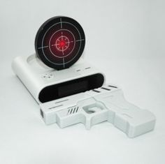 ETALAGE   MEN - GUN ALARM CLOCK  you actually need to shoot the target to stop the alarm from buzzing. How cool is that for you boys.