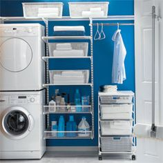I really like this #ContainerStore laundry room. I like the idea of having a place to hang the clothes when they come out of the dryer.