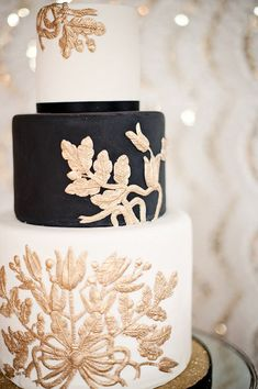 black white and gold wedding cake, looks like embroidery.