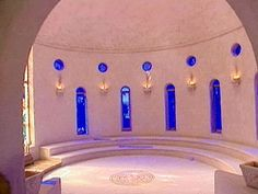 """Love this idea.   The inside of Russell Crowe's chapel is breathtaking! With an eye for detail and a vision of romance, Russell made sure the stained glass window was strategically placed to capture the beauty of the sunlight streaming in...the moment they exchanged their vows. The chapel is circular to create """"circles of friends""""; the mosaic floor is from the second century A.D."""