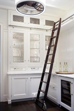 """why stop the eye 12"""" before the wall??? Leaded glass inserts are a fabulous way to extend a cramped pantry visually! A must!"""