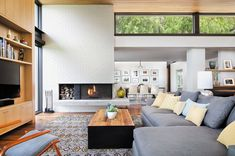 Inside a mid-century home reimagined with stunning details on Lake Austin #livingroom #fireplace #clerestory