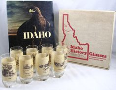 """Idaho History Glasses.  A Bicentennial Tribute to Idaho from Red Steer.  """"Idaho"""" by Robert O. Beatty, Published by The First National Bank of Idaho 1977."""