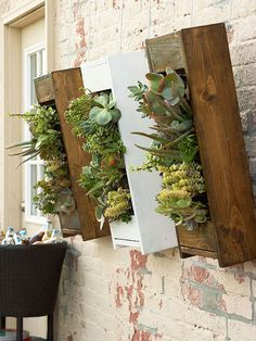Look to Walls  The trick to expanding space in a small area is going vertical. Living wall planters do just that. The divided trays hung in wooden frames create an artlike display while freeing space on the patio or deck.