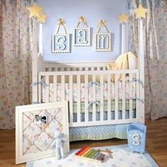 Not a fan of this, but I LOVE the frames hanging above the cot....... Cute idea!!