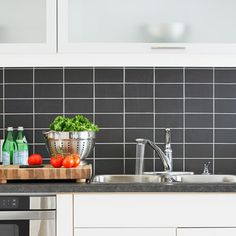 Kitchen with backsplash of black subway tiles stacked with white grout from This Old House Magazine.