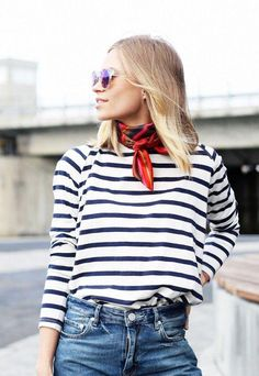 Channel the French in a striped shirt, blue jeans, and vintage silk scarf neckerchief. Love this street style-inspired outfit idea! Trendy and classic.