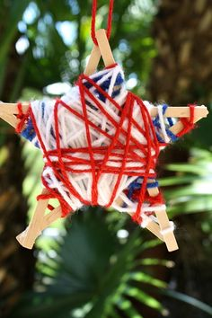 These red, white and blue yarn-wrapped stars make a great patriotic decoration or Fourth of July craft necklace for kids.