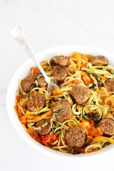 Sausage and Peppers with Zucchini Noodles Recipe on twopeasandtheirpod.com Sweet and spicy Italian sausage with peppers, onions, and zucchini noodles in a simple garlic tomato sauce. The entire family will love this quick and easy meal!