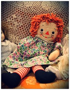Sweet picture of a vintage Georgene Raggedy Ann in a pretty print dress...