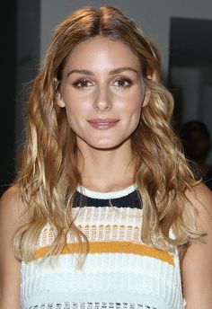 Swerving her usual sleek-in-The-City vibes and serving up Cali-girl realness instead, the secret behind Olivia Palermo's tousled waves is all in the tongs. Take a barrel tong to your tresses but – and take note – avoid curling above your ears. Separate your spirals with your fingers to create volume and keep your middle parting neat. Set with texturising spray