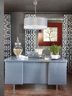 Upgrade a plain drum pendant by using a hot glue gun to attach decorative trim around its perimeter.