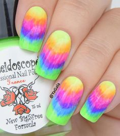 you can try this rainbow nail art design which kinda resembles a tie-dye shirt, right?