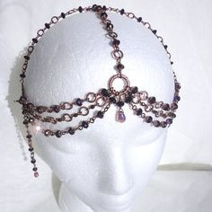 One of my own: Renaissance Headdress with Metallic Purple Crystals by astraeadesigns, via Etsy.
