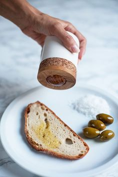 Oaza Oil-On - roll-on olive oil dispenser...ummm incredible for keeping our bread and cheese addiction in full swing.