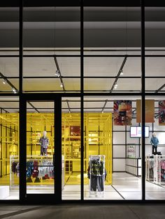 Uptown Kids by Elliott + Associates Architects.  The store includes an airy, contemporary design that beautifully showcases the clothing and accessories.