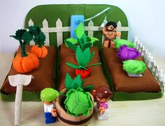 Felt food pattern,felt toy ,Vegetable Garden by fairyfox.  It looks like the overseer is whipping his minions so they will harvest cabbage with increasing speed.  Or maybe it is just me.