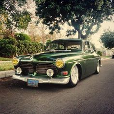 Volvo 122. Looks like it belongs at the University of Oregon, Go Ducks!