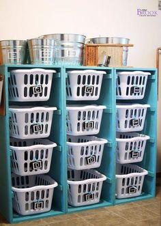 What a great way to organize laundry baskets. You could label each one according to color and have your laundry sorted before you even go to wash it!