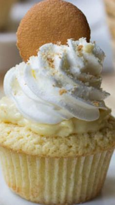 Banana Pudding Cupcakes ~ The cupcake version of banana pudding with a creamy pudding center, whipped topping and crushed vanilla wafers.