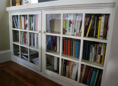 every house should have built-in bookcases, these ones are particularly nice. Doors to protect and keep clean. Glass windows for aesthetic and visual appeal. And height to keep clutter out of eye's line of sight and create a counter space.